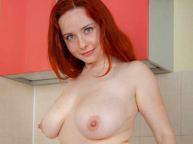 Sara Nikol strips in the kitchen