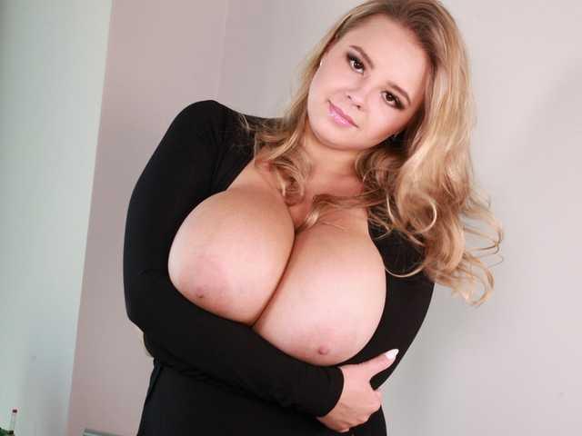 Vivian Blush in a black dress