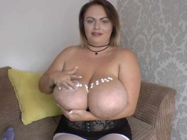 Charley lotions her huge tits